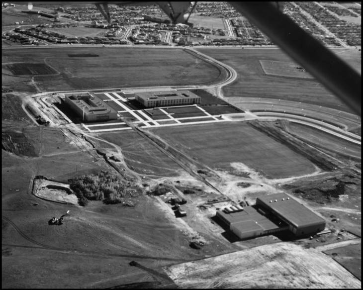 Aerial view of the early campus with Science A in the background